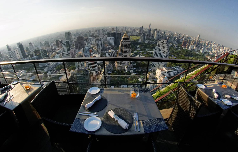 Table with two chairs with view over the sky line of Bangkok at Vertigo & Moon Bar