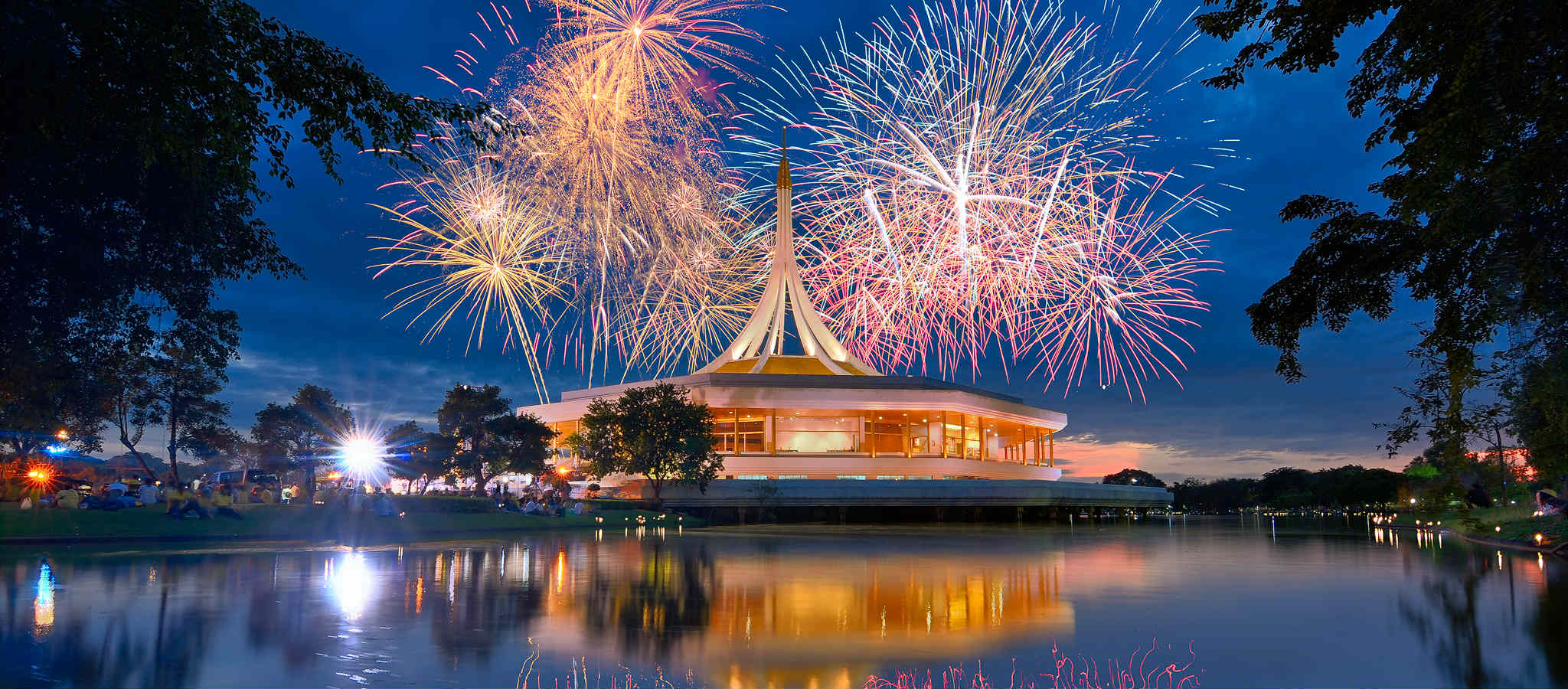 Firework show and the golden pavilion that looks like an UFO in King Rama IX Park