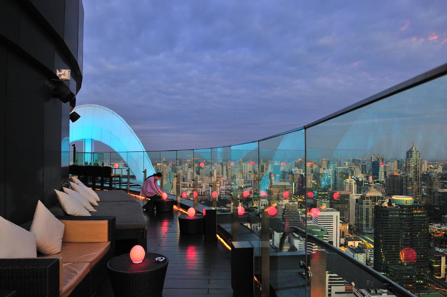Terrace with lounge seats and amazing view over de sky line of Bangkok from Red Sky in Bangkok