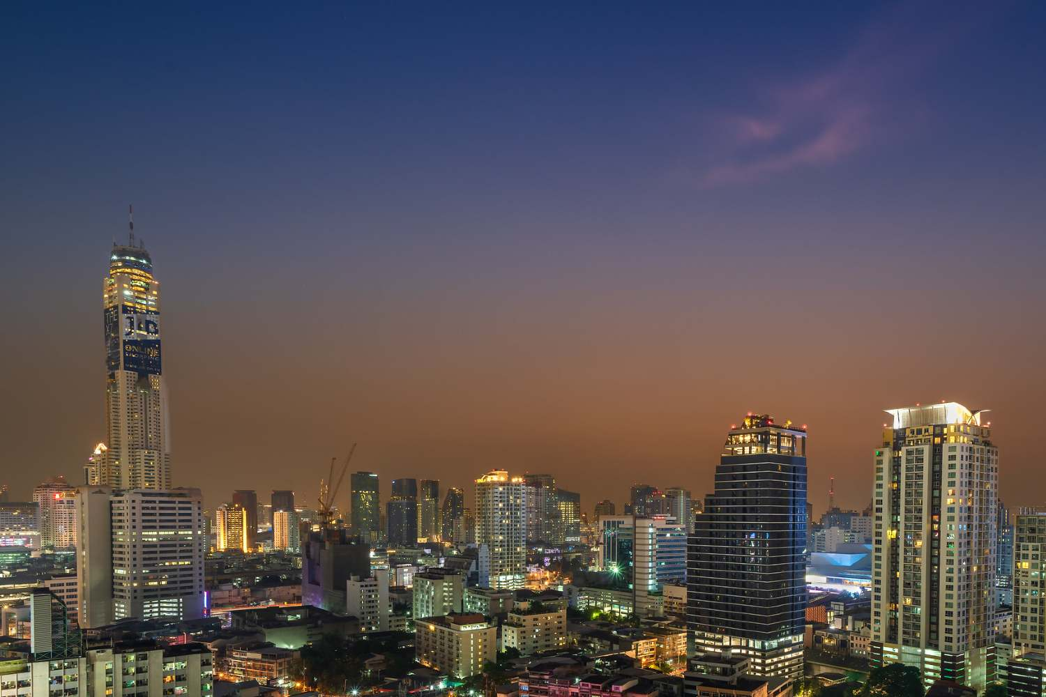 View over the sky line of Bangkok with the Baiyoke Sky Bar in the distance