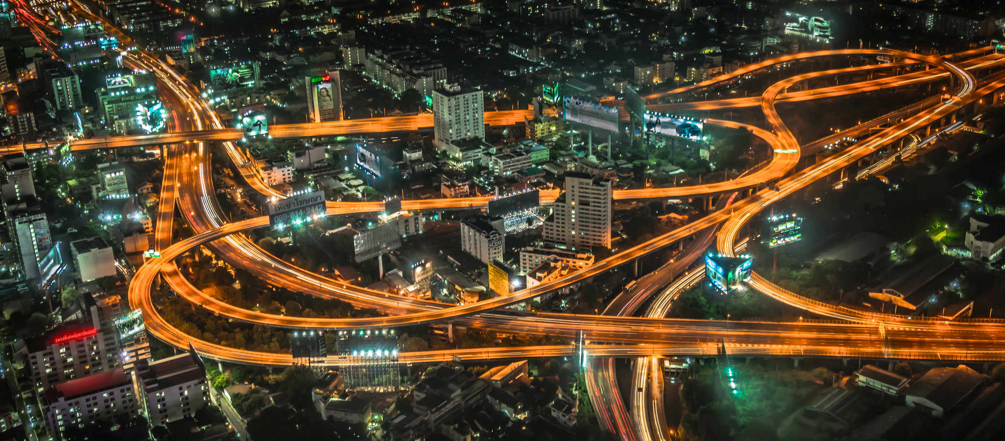 Illuminated highways at night in Bangkok, from the 84th floor of the Baiyoke Sky in Bangkok