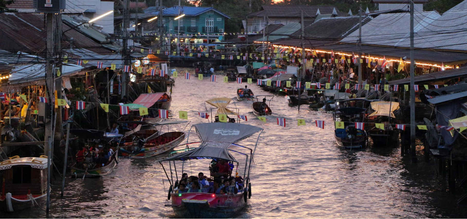 View from a bridge over the Amphawa Floating Market in Bangkok