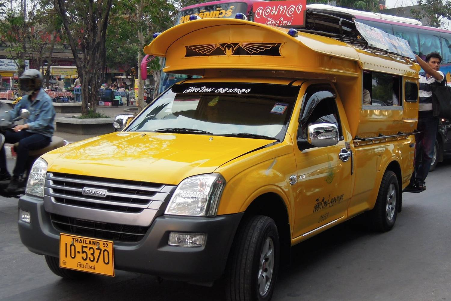 A yellow songthaew in Chiang Mai
