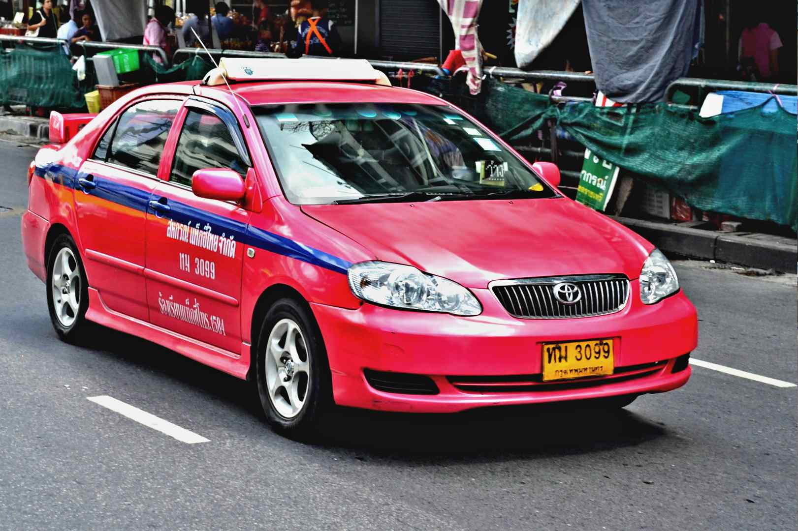 Pink / Red taxi in Bangkok