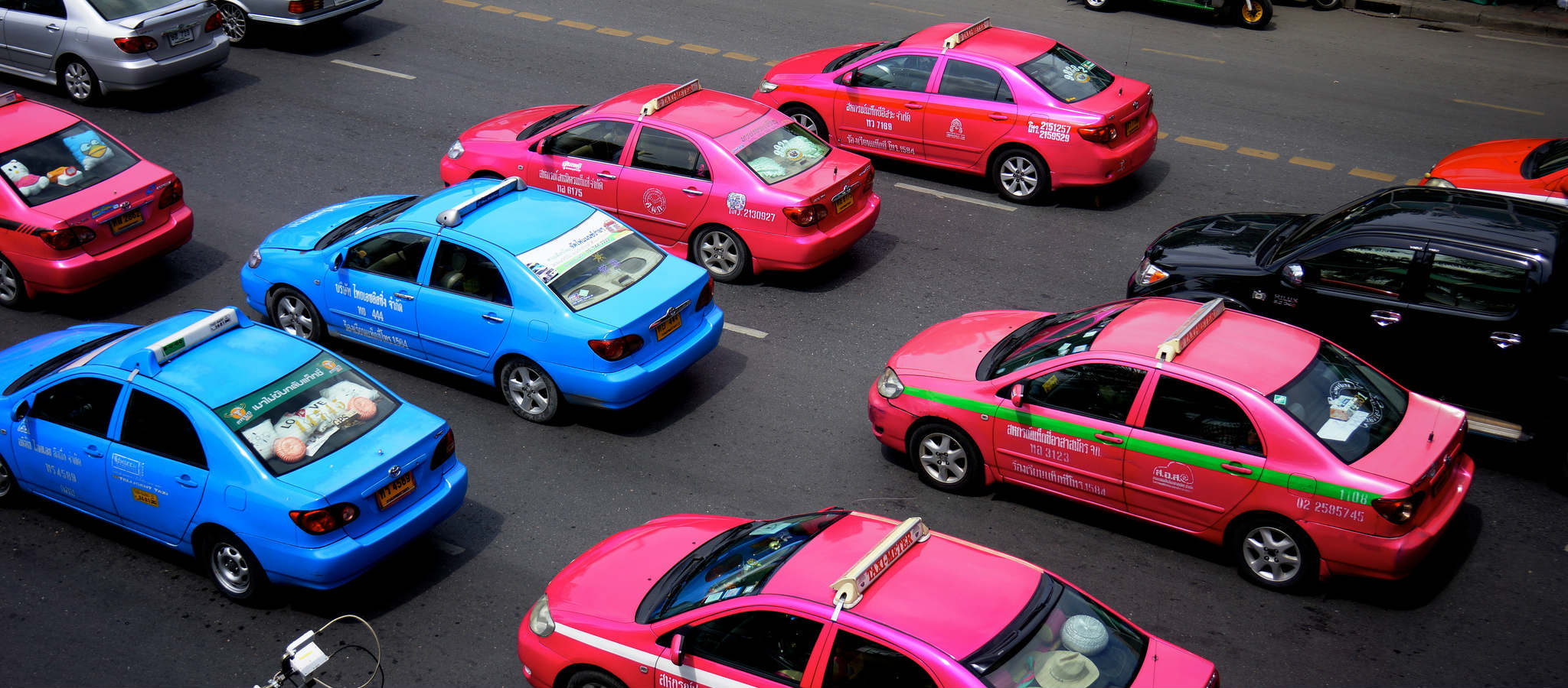 Pink and blue taxis in Bangkok