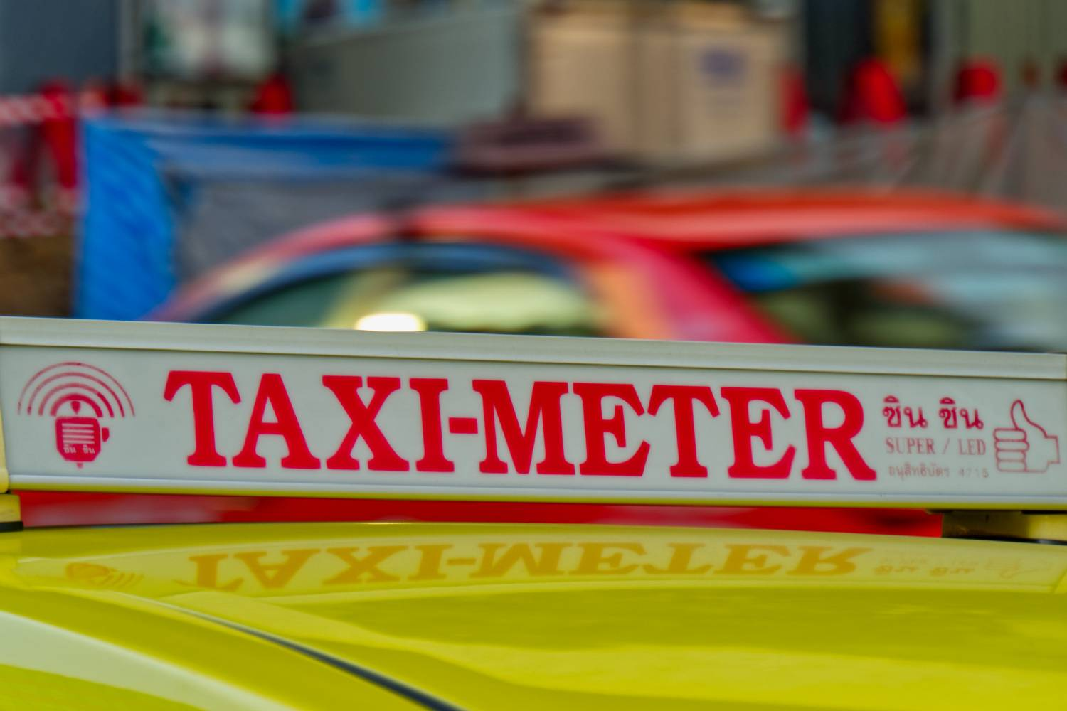 Taxi meter sign on a taxi in Bangkok