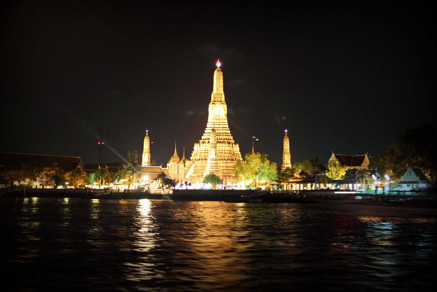 The Wat Arun illuminated at night