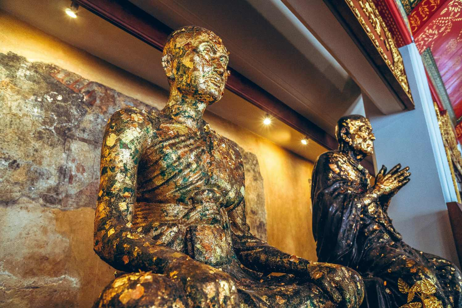 Golden statues of important monks at the Wat Pho temple complex in Bangkok