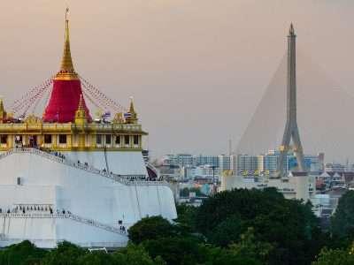 A View At The Wat Saket And Rama VIII Bridge In Bangkok