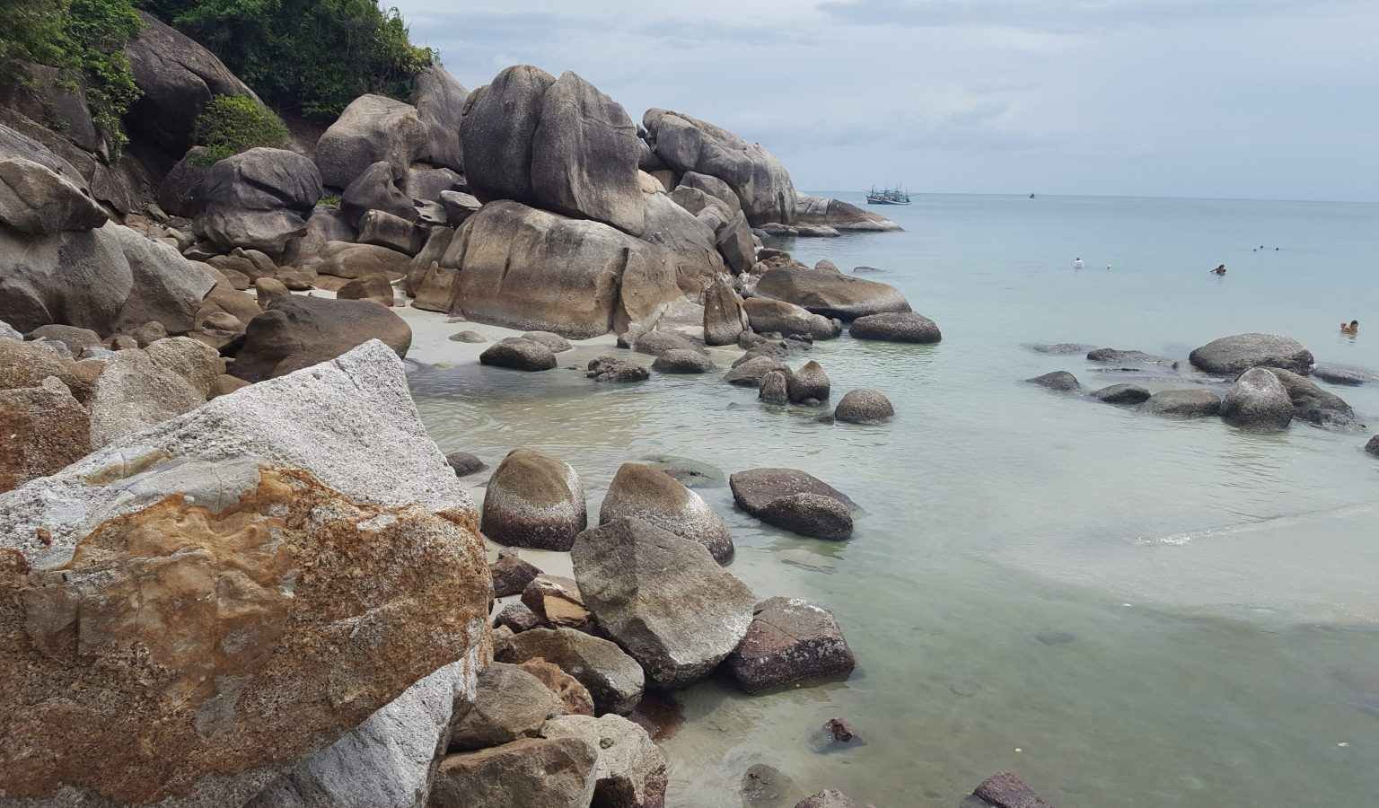 Rocks in the shallow water in the bay of Crystal Beach on Koh Samui