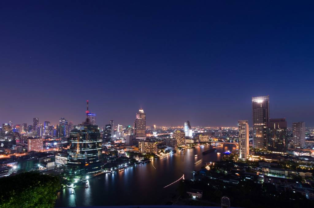 Sky Line at night with view over the Chao Phraya River and Bangkok skyline from the Three sixty sky bar