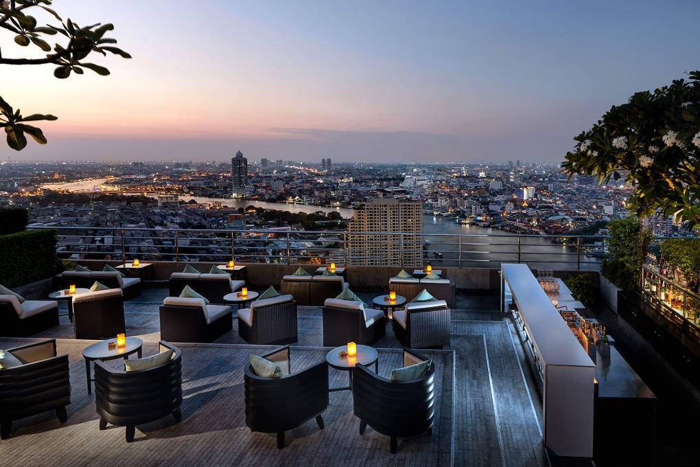 View of the outdoor bar of the ThreeSixty Jazz Lounge and Rooftop Bar at the Millennium Hilton Bangkok in Thailand with spectacular views over the city of Bangkok.