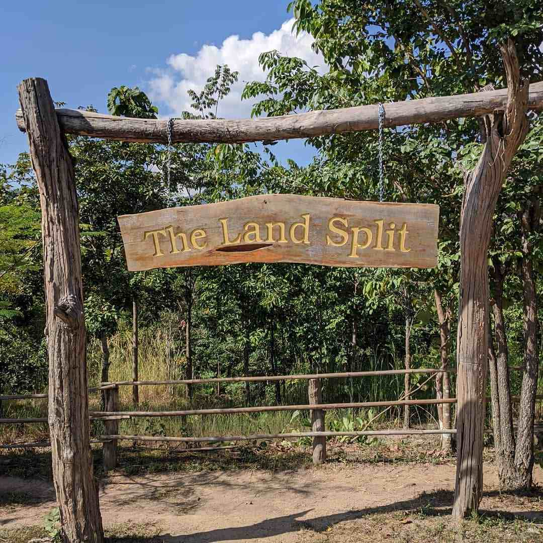 The sign with The Land Split on it (Pai Thailand)