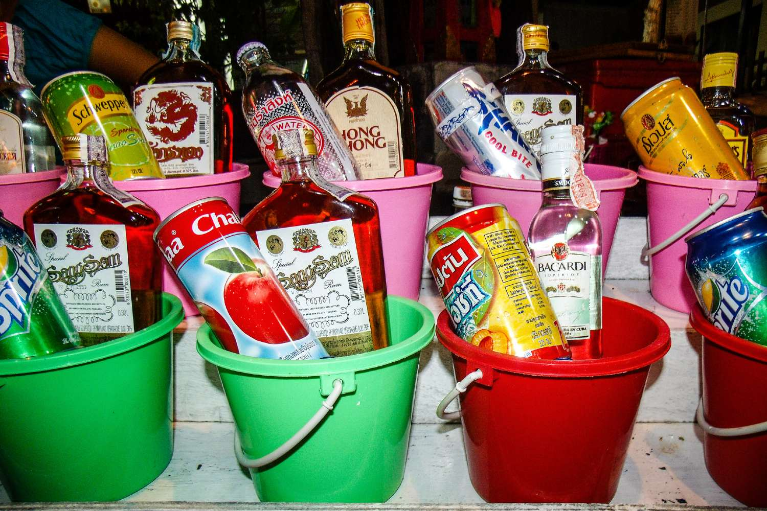 Buckets of different types of spirits at the Full Moon Party on Koh Phangan