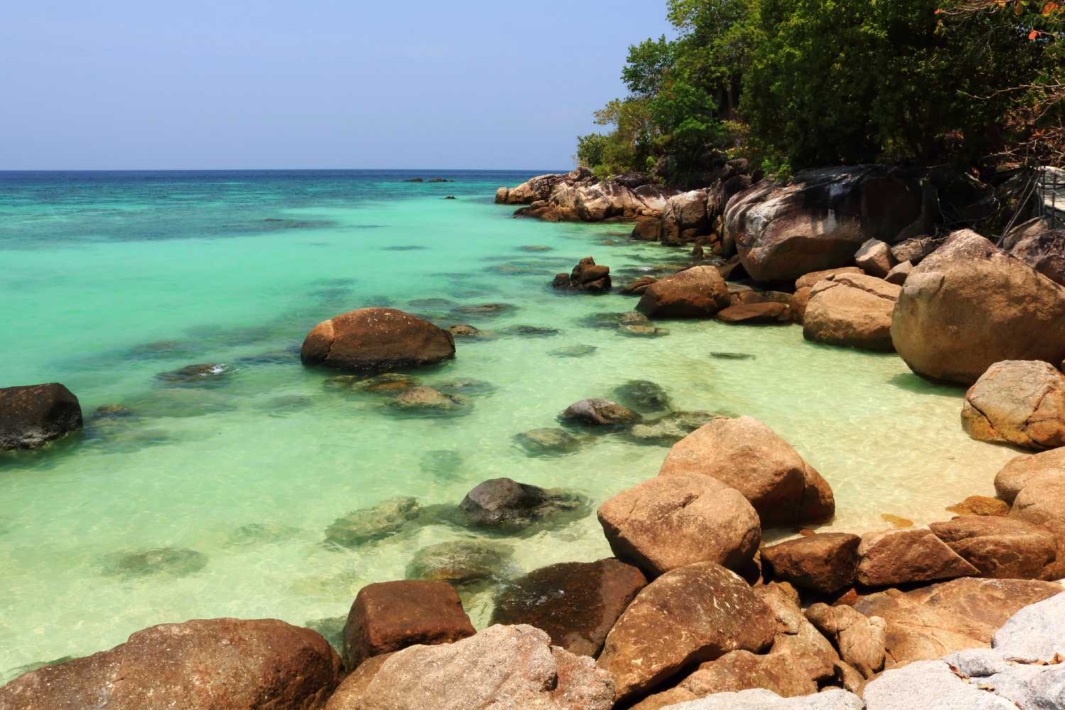 the beautiful and clear blue-green seawater of Pattaya Beach on Koh Lipe, Thailand