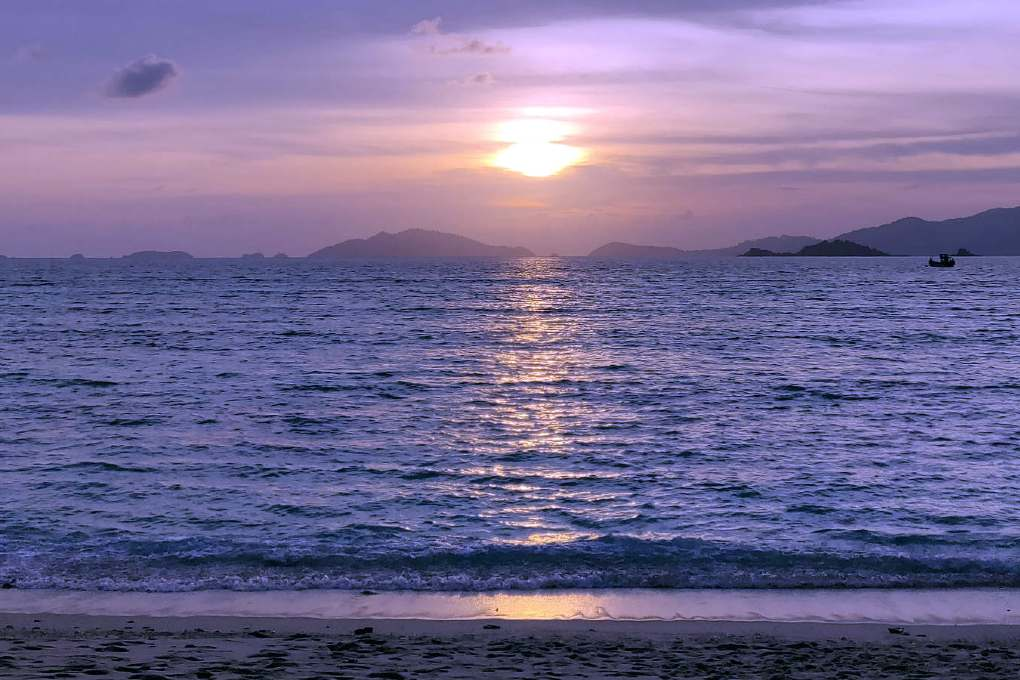 Sunset with purple sky on Sunset Beach Koh Lipe, Thailand