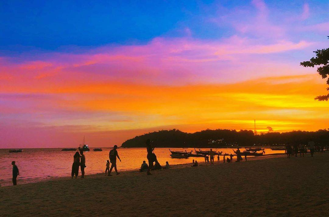 The beach and sea of Pattaya Beach on Koh Lipe at sunset