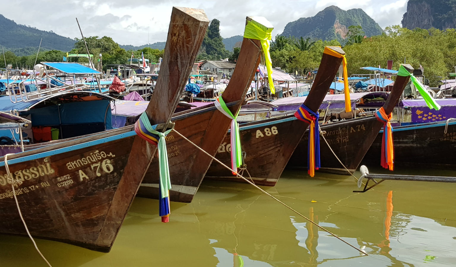 Longtail boats ready for departure at the pier of Ao Nang Krabi