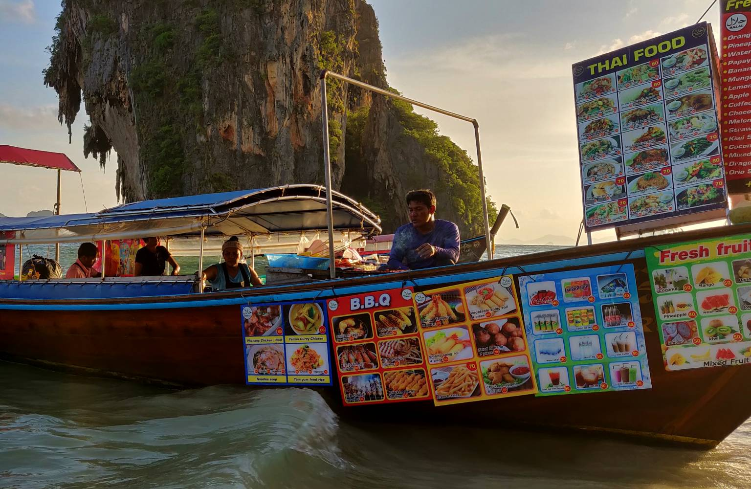 longtailboat with food at Ao Pranang Beach, Krabi