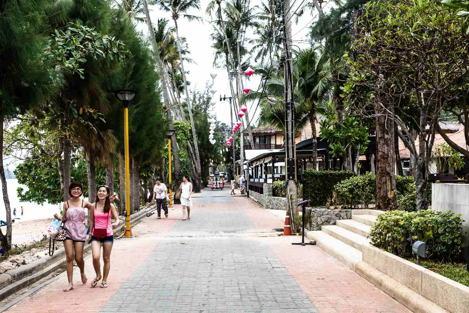 Narrow promenade with hotels and restaurants towards the eastern part of Ao Nang Beach