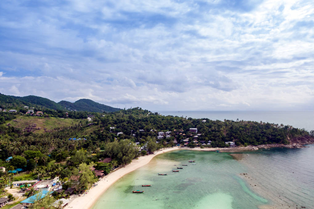 Overview picture with a drone of the beach Haad Salad, on the island of Koh Phangan in Thailand.