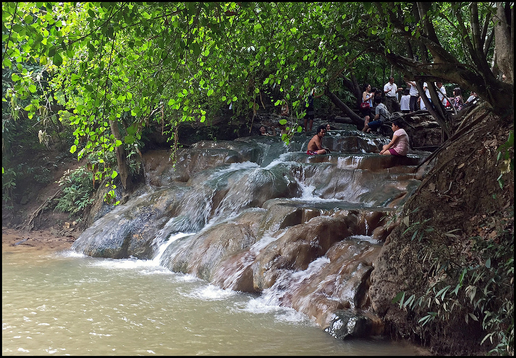 People bathe in waterfall on the river Krabi Hot Springs , Namtok Ron in Krabi