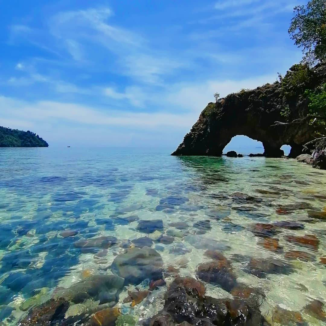 Koh Khai with the famous arch in the rocks of the island