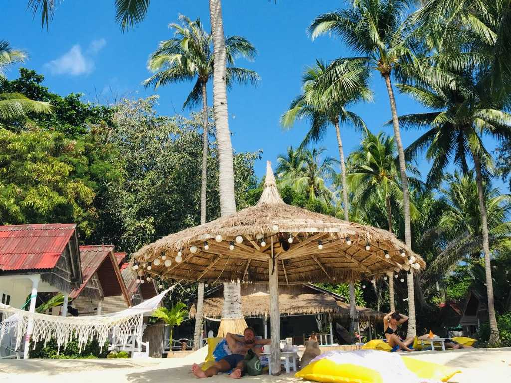 Chill out under an umbrella on the beach at Sea Love Bungalows on Koh Phangan