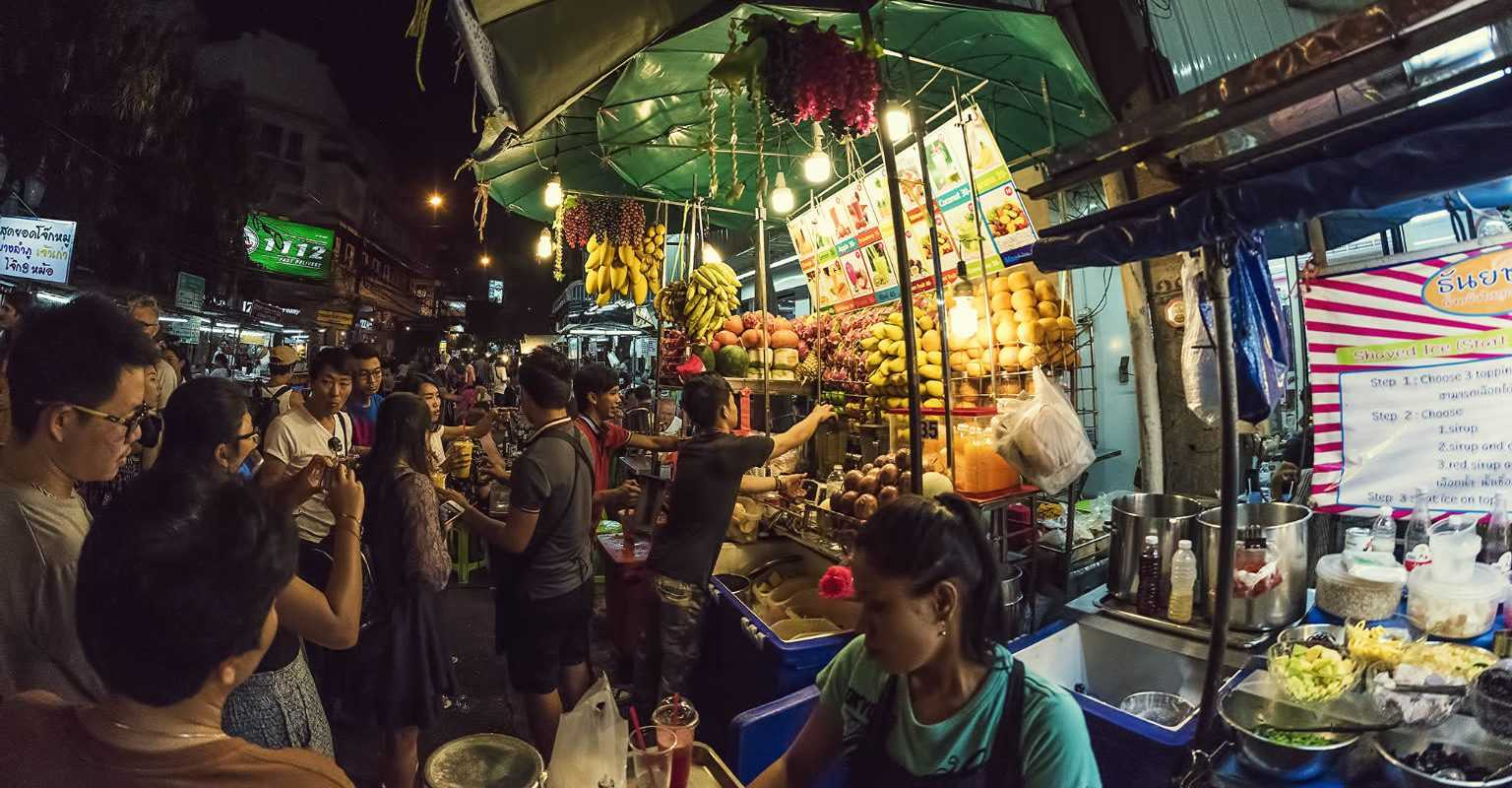 Hustle and bustle at one of the food stalls on Rambuttri Road in Bangkok