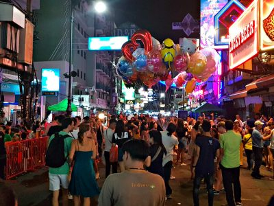 Partying People, Balloons And Neon On Khao San Road, Backpacker Street In Bangkok, Thailand
