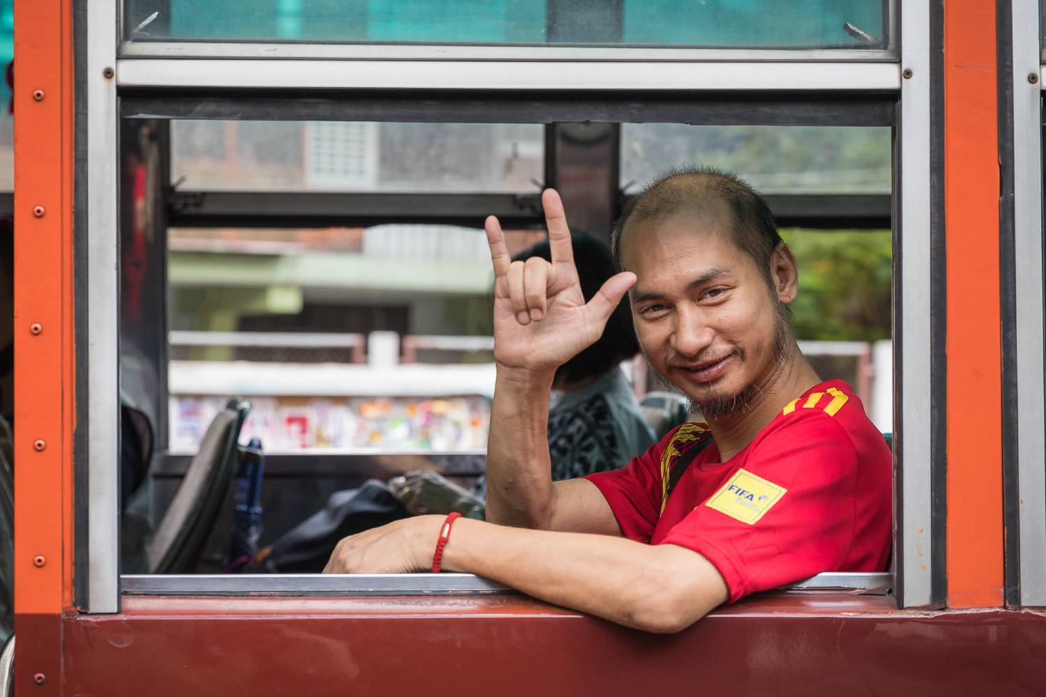 Friendly hello from a bus in Bangkok