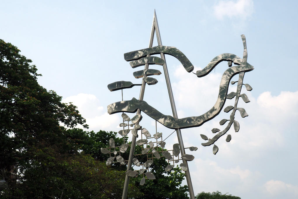 Sculpture of the dove of peace with olive branch in her mouth in Santhiphap Park in Bangkok, Thailand.