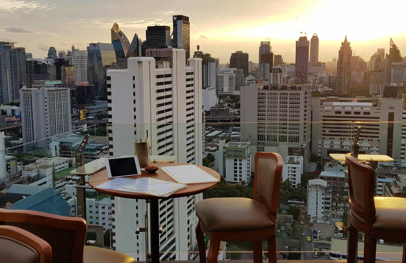 View over Bangkok's sky line at the Above Eleven sky bar at sunset