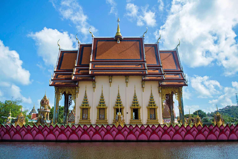 Wat Plai Laem Temple on floating lotus flower in the water