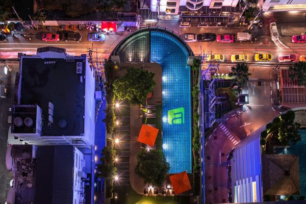 Beautifully designed pool the Aloft Bangkok hotel with views over Bangkok in the evening.