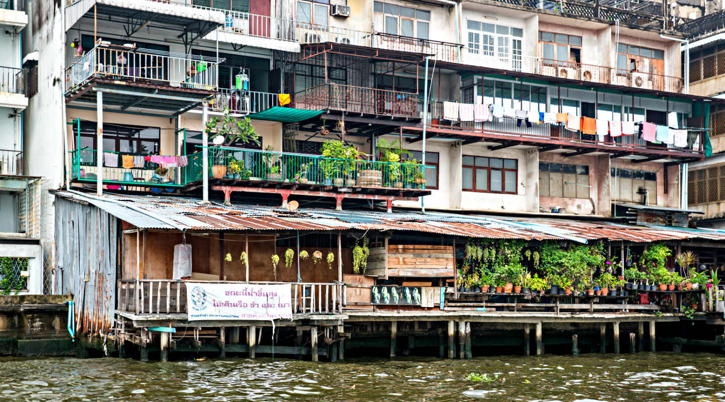 Cottages along the Chao Phraya River, Bangkok, Thailand