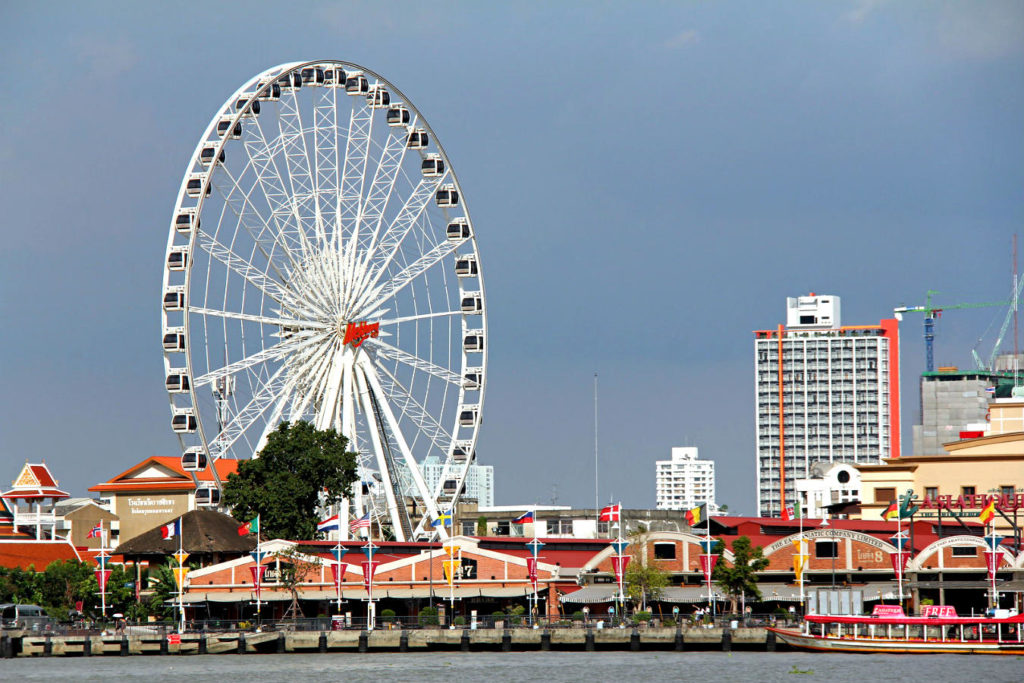 White Ferris wheel of ASIATIQUE The Riverfront Market seen from the Chao Phraya River in Bangkok