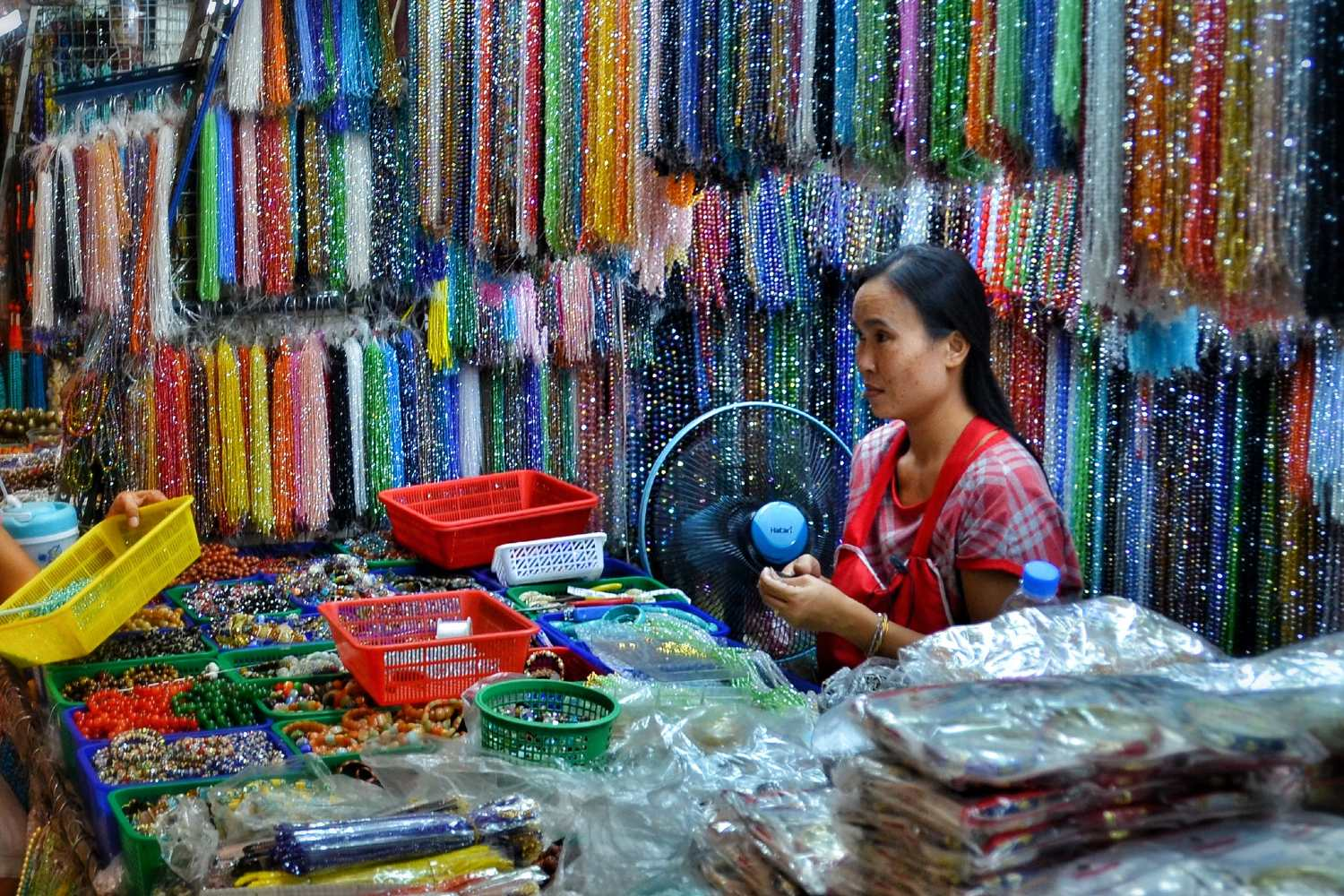 Chinatown, Phahurat Market (Little India) Seller with coloured bead necklaces.