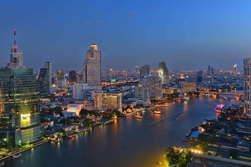 Chao Phraya River Bangkok and surroundings fairytale illuminated in the evening, Bangkok in Thailand