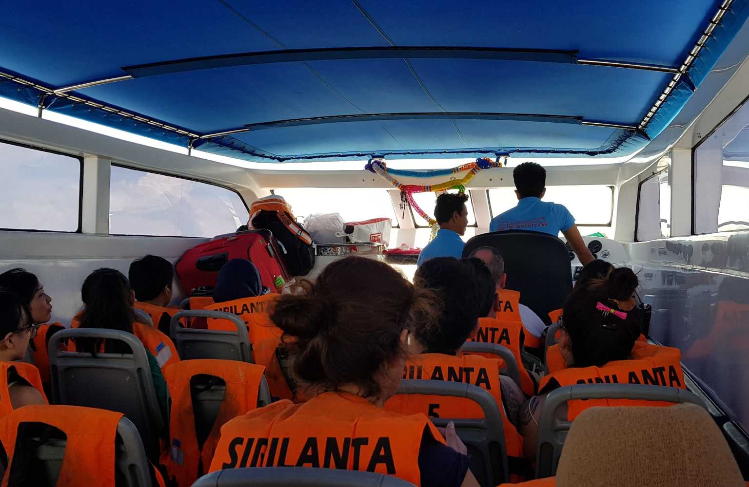 People in the speedboat from Pak Bara to Koh Lipe all wearing orange life jackets.