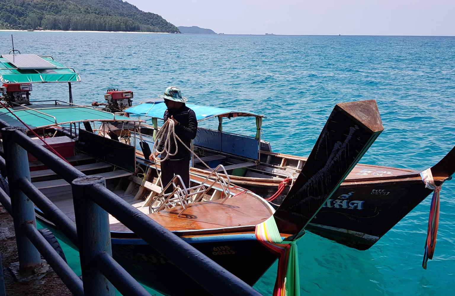 By longtail boat from the platform into the sea to Koh Lipe in Thailand