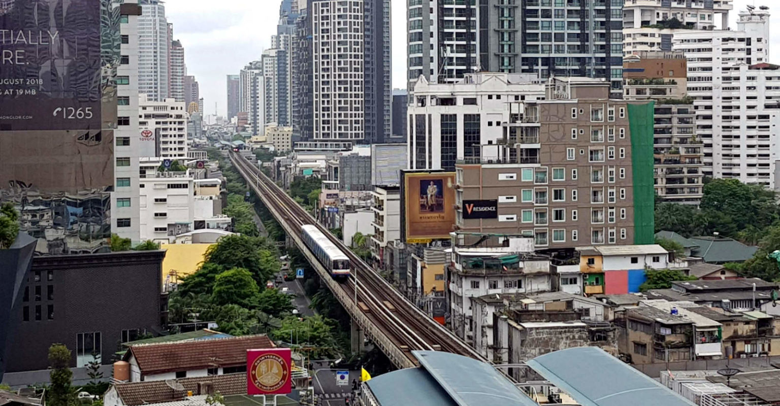 BTS Sky Train in Siam Square between the tall buildings of Bangkok
