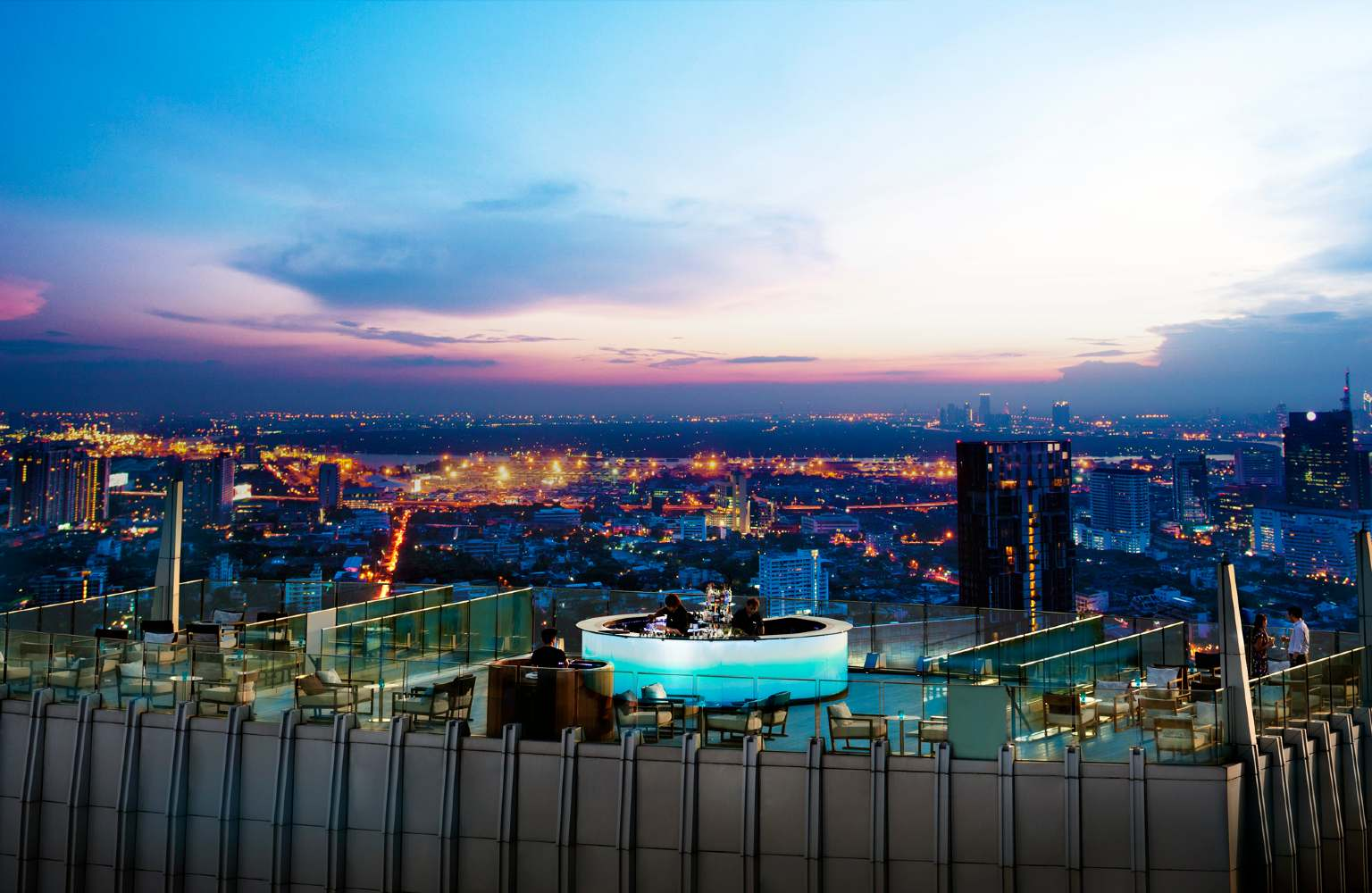 The round with neon blue lit bar on the roof of the Octave Sky Bar (Marriott Bangkok)