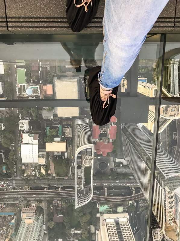 First step on the glass platform of the Mahanakhon SkyWalk in Bangkok