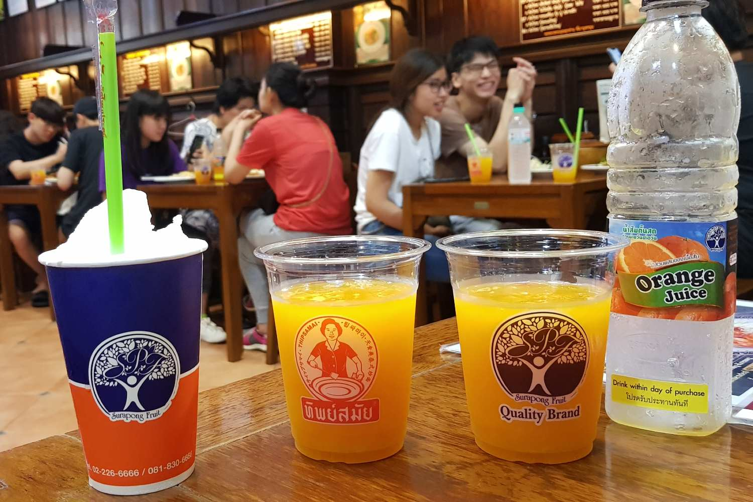 Super yummy orange juice and icy coconut at thipsamai in Old Town Bangkok