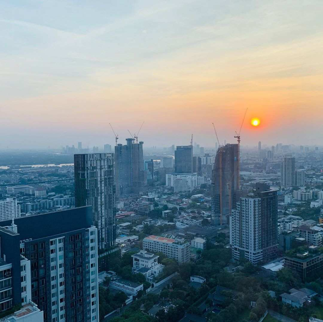 Sunset and views over the skyline of Bangkok from the Octave Rooftop Bar in Bangkok