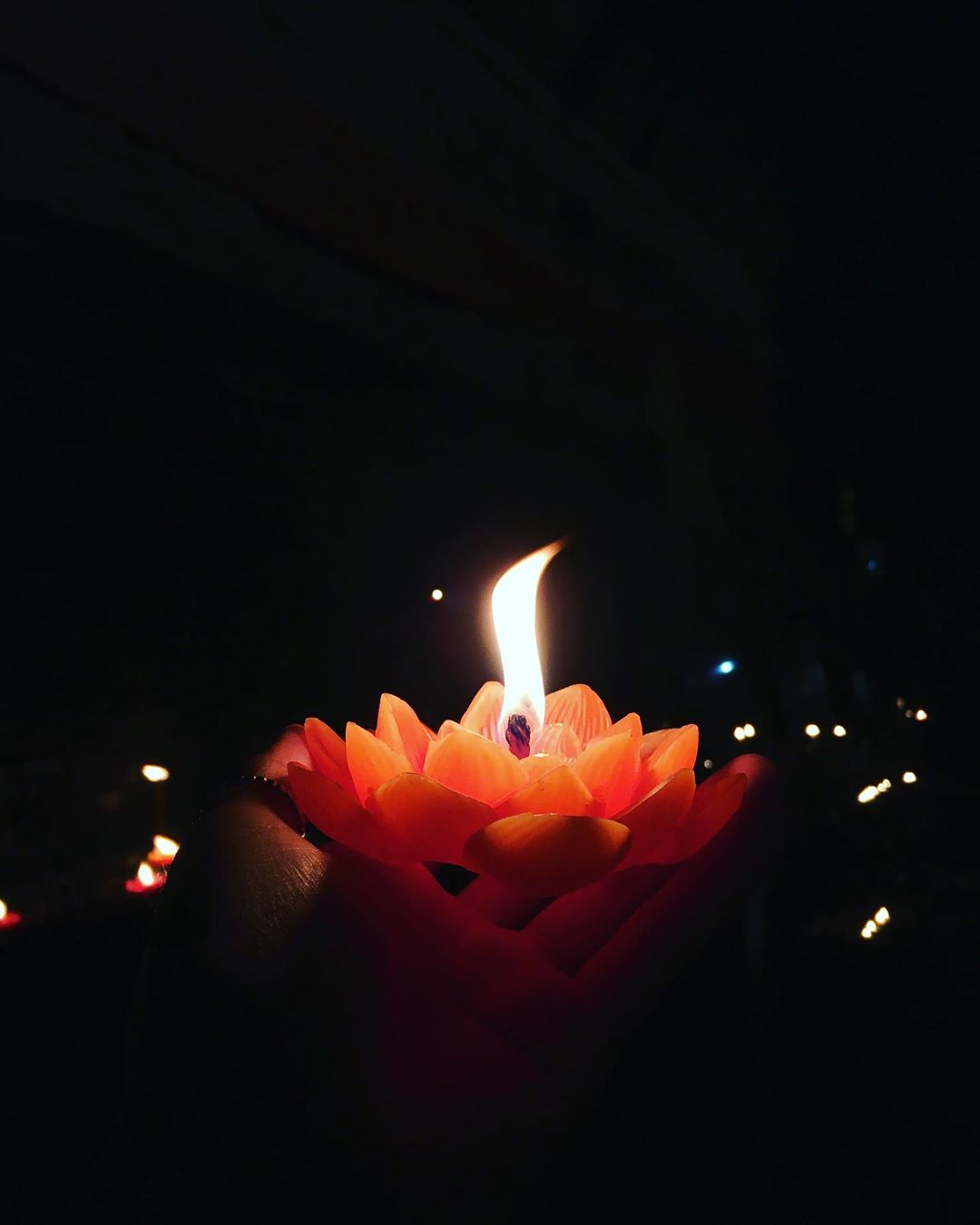 Floating Krathong resembling a lotus flower with a burning candle inside during Loy Krathong 2019