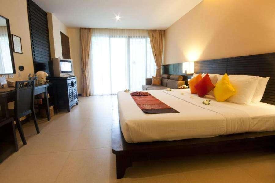 Een slaapkamer van het Sunrise Tropical Resort