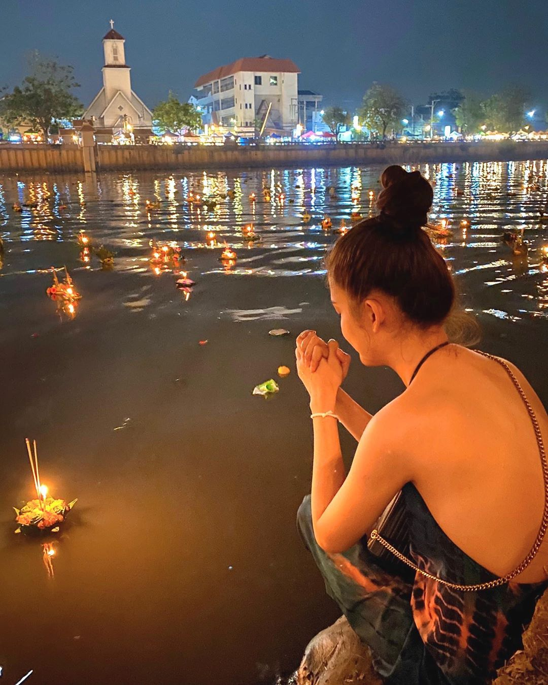 Girl praying by the river during Loy Krathong 2019