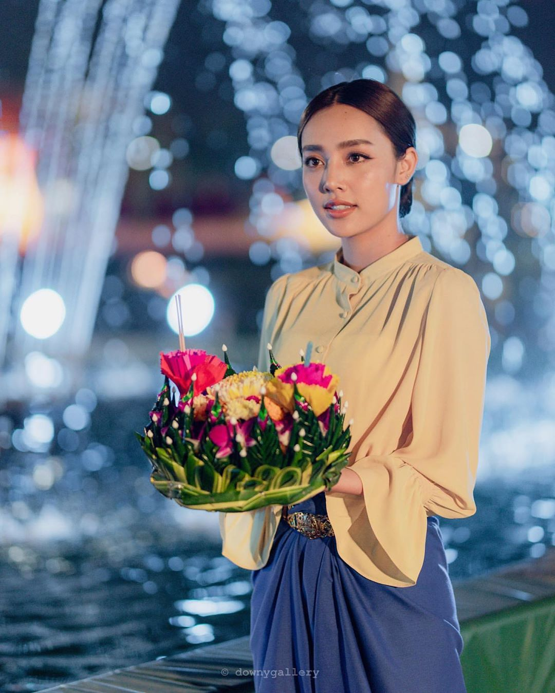 Girl with her made Krathong in her hands during Loy Krathong 2019
